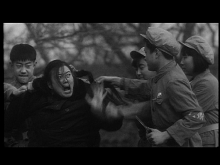 Teacher attacked by Red Guards B&W
